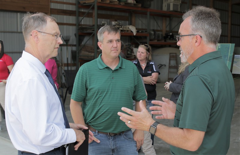 MFB Director Jeff Sandborn speaks with Eaton County farmer Duane Smuts and MDARD Director Gary McDowell.