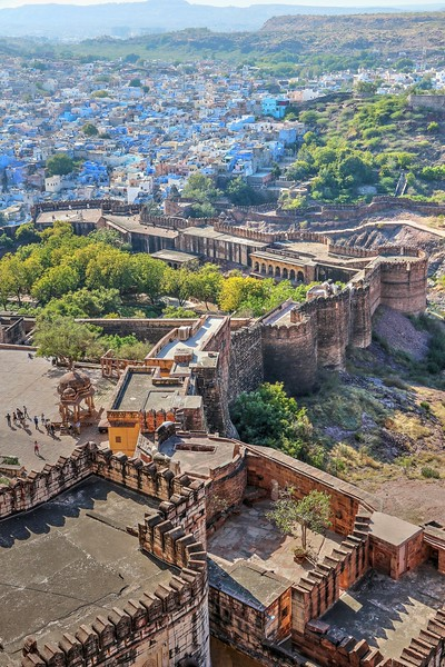 "Stretching out from the walls of the fort, the tangle of winding medieval streets filled with a jumble of Brahmin-blue cubes gives Jodhpur it's nickname ""The Blue City"""