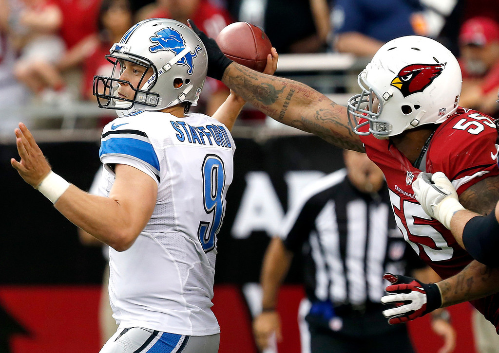 . Arizona Cardinals defensive end John Abraham (55) can\'t get a hand on the ball as Detroit Lions quarterback Matthew Stafford (9) throws during the second half of a NFL football game, Sunday, Sept. 15, 2013, in Glendale, Ariz. (AP Photo/Ross D. Franklin)