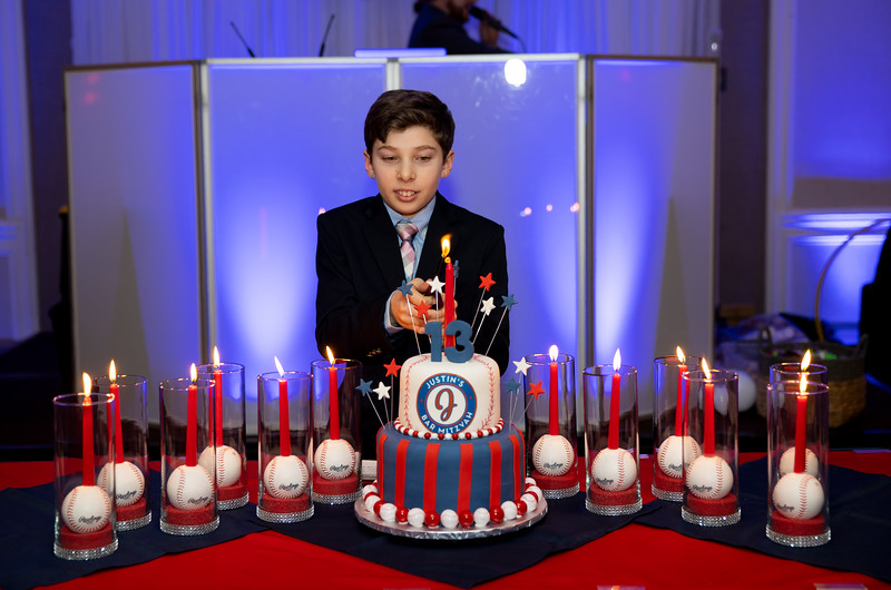 Justin Lighting the last candle.jpg