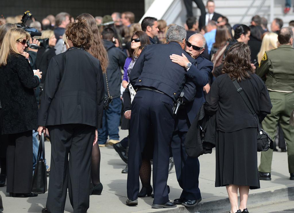 ". People gather outside at the HP Pavilion in San Jose, Calif., on Thursday, March 7, 2013. Thousands are expected at the pavilion to mourn the loss of Santa Cruz police officers Loran ""Butch\"" Baker and Elizabeth Butler, who lost their their lives in the line of duty on Feb. 26. (Dan Honda/Bay Area News Group)"