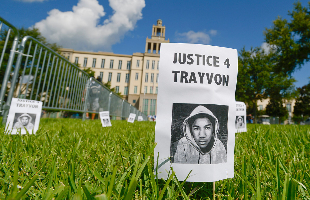 . Signs with a photo of Trayvon Martin are displayed in front of the Seminole County Courthouse during jury deliberations in the George Zimmerman trial, Saturday, July 13, 2013, in Sanford, Fla. Zimmerman has been charged in the 2012 shooting death of Trayvon Martin. (AP Photo/Phelan M. Ebenhack)
