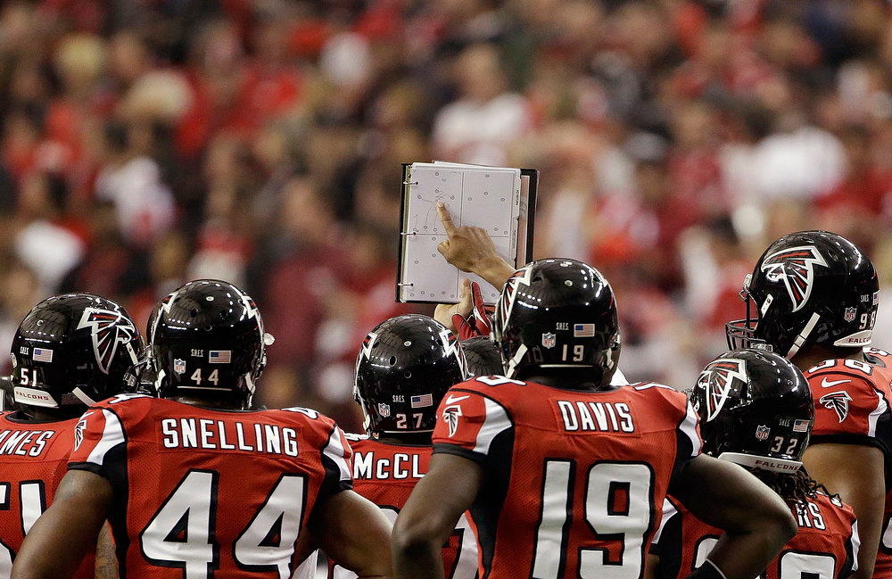 Description of . The Atlanta Falcons study a play during the first half of the NFL football NFC Championship game against the San Francisco 49ers Sunday, Jan. 20, 2013, in Atlanta. (AP Photo/Mark Humphrey)