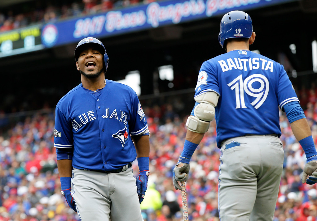 . Toronto Blue Jays\' Edwin Encarnacion, left, celebrates his solo home run with Jose Bautista (19) in the fifth inning of Game 2 of baseball\'s American League Division Series against the Texas Rangers on Friday, Oct. 7, 2016, in Arlington, Texas. (AP Photo/LM Otero)