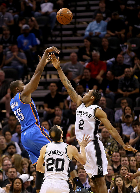 . Kevin Durant #35 of the Oklahoma City Thunder shoots over Kawhi Leonard #2 of the San Antonio Spurs in the first half in Game Two of the Western Conference Finals during the 2014 NBA Playoffs at AT&T Center on May 21, 2014 in San Antonio, Texas.   (Photo by Ronald Martinez/Getty Images)