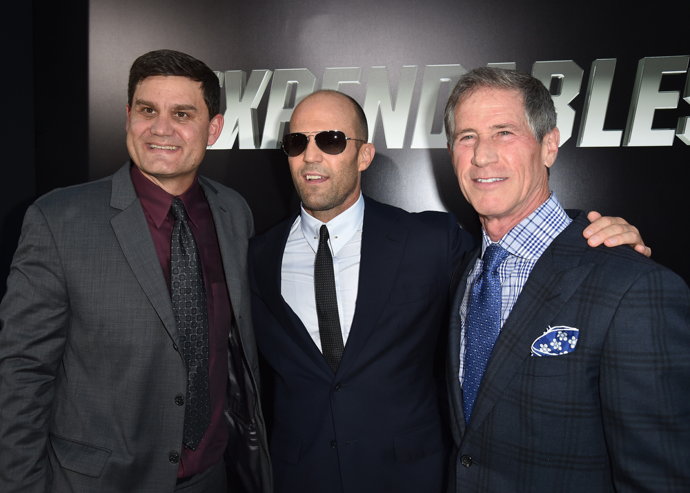 """. Motion Picture Group of Lions Gate Entertainment Corp. President of Acquisitions & Co-productions Jason Constantine, actor Jason Statham and Chief Executive Officer of Lions Gate Entertainment Jon Feltheimer attend the premiere of Lionsgate Films\' \""""The Expendables 3\"""" at TCL Chinese Theatre on August 11, 2014 in Hollywood, California.  (Photo by Kevin Winter/Getty Images)"""