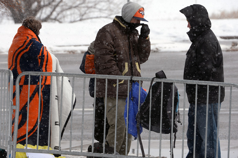 . A small gathering of fans stood out in sub-freezing weather hoping to get autographs from some of the players as they leave Dove Valley for the season in Englewood, Co on February 4, 2014. (Photo By Helen H. Richardson/ The Denver Post)
