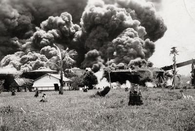 Smoke from burning oil tanks