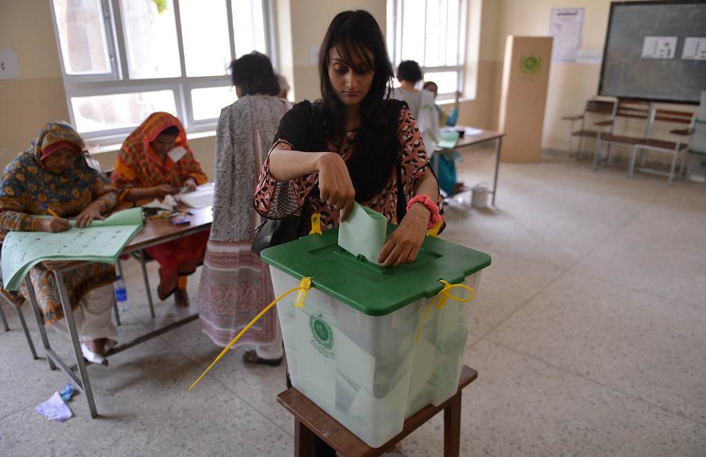 . A Pakistani resident casts her vote at a polling station in Islamabad on May 11, 2013. Pakistanis queued up to vote in landmark elections, defying Taliban attacks to cast their ballots in polls marking a historic democratic transition for the nuclear-armed state. AAMIR QURESHI/AFP/Getty Images