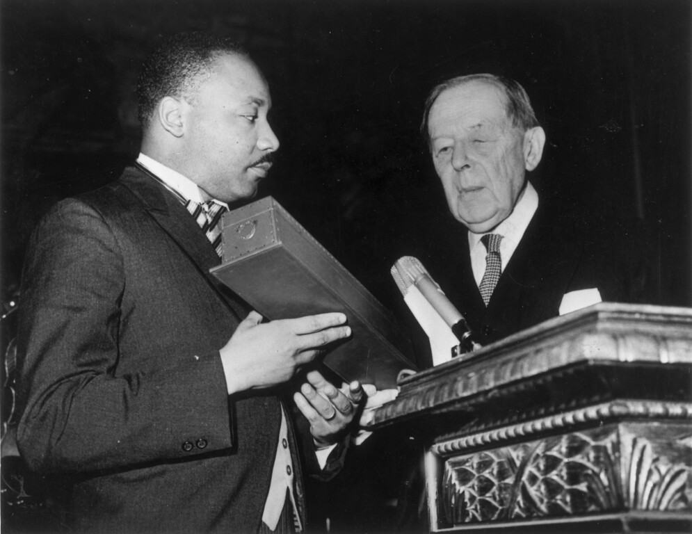 . 10th December 1964:  American civil rights leader Martin Luther King (1929  - 1968) (left) receives the Nobel Prize for Peace from Gunnar Jahn, president of the Nobel Prize Committee, in Oslo.  (Photo by Keystone/Getty Images)