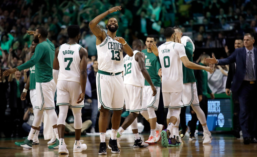 . Boston Celtics forward Marcus Morris (13) and teammates celebrate near the end of the second half in Game 2 of the NBA basketball Eastern Conference finals against the Cleveland Cavaliers, Tuesday, May 15, 2018, in Boston. (AP Photo/Charles Krupa)