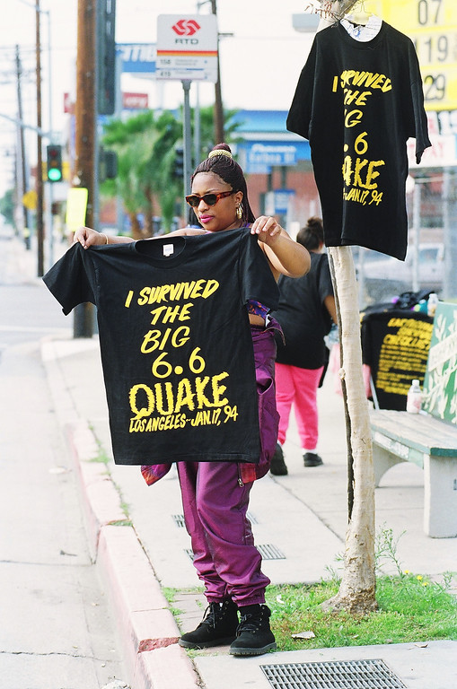 . Marie Thomas hawks T-shirts on the corner of Balboa Boulevard and Devonshire Street.   Los Angeles Daily News file photo