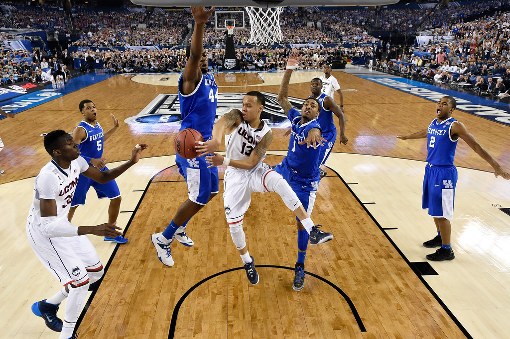 . ARLINGTON, TX - APRIL 07:  Shabazz Napier #13 of the Connecticut Huskies passes as James Young #1 of the Kentucky Wildcats defends during the NCAA Men\'s Final Four Championship at AT&T Stadium on April 7, 2014 in Arlington, Texas. (Photo by Chris Steppig-Pool/Getty Images)