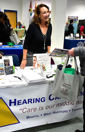 4/6/2019 Mike Orazzi | Staff Hearing Care Centers' Nancy Duffy during the 5th Annual Connecticut Prime Time Senior Fair Saturday at Bristol Eastern High School.