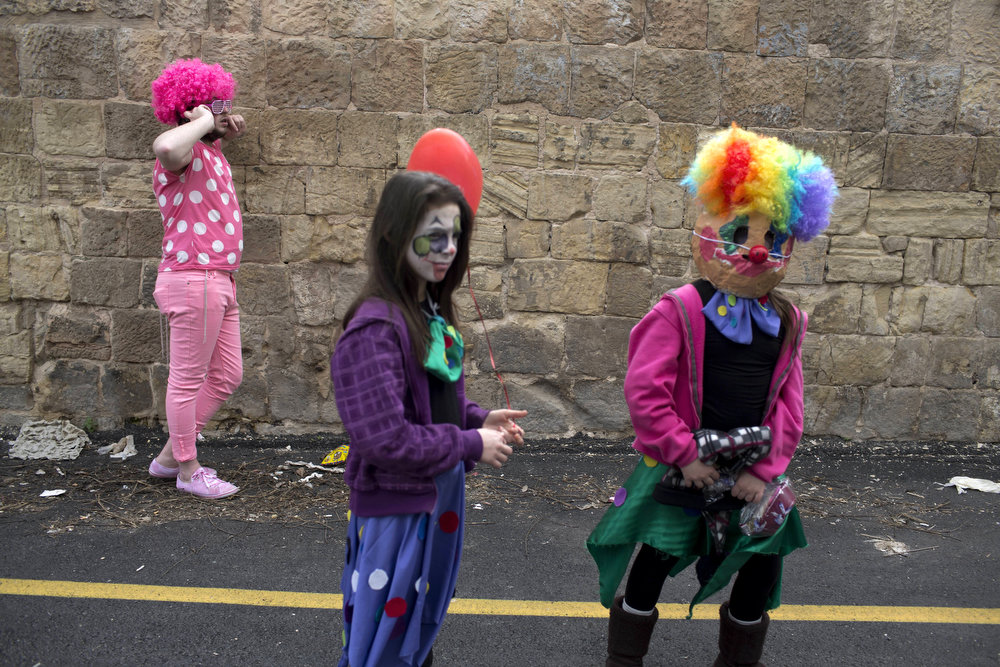 Description of . Israeli settlers take part in the annual Purim parade in the occupied West Bank city of Hebron on February 24, 2013. The carnival-like Purim holiday is celebrated with parades and costume parties to commemorate the salvation of the Jews from the ancient Persians as described in the biblical book of Esther. MENAHEM KAHANA/AFP/Getty Images