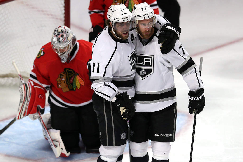 . CHICAGO, IL - JUNE 08:  Anze Kopitar #11 and Jeff Carter #77 of the Los Angeles Kings celebrate after Kopitar scored a goal in the third period against goalie Corey Crawford #50 of the Chicago Blackhawks during Game Five of the Western Conference Finals of the 2013 NHL Stanley Cup Playoffs at United Center on June 8, 2013 in Chicago, Illinois.  (Photo by Jonathan Daniel/Getty Images)