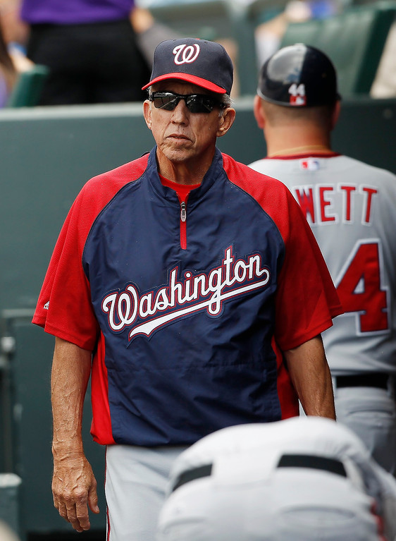 . Washington Nationals manager Davey Johnson paces in the dugout as his team bats against the Colorado Rockies in the fourth inning of a baseball game in Denver, Thursday, June 13, 2013. (AP Photo/David Zalubowski)