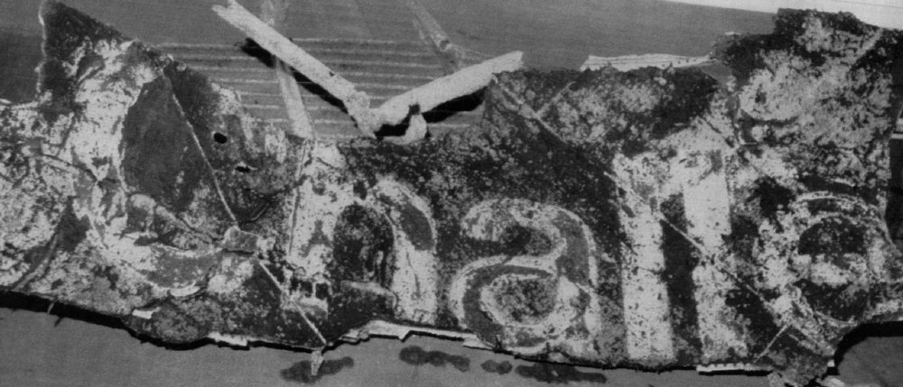 """Description of . Nasa released this photo showing a 9\'7\"""" by 16 segment of Challenger\'s right wing. The wreckage was brought in to Port Canaveral by the USS Opportune. The wreckage was recovered from under 70 feet of water about 12 nautical miles northeast of Cape Canaveral."""