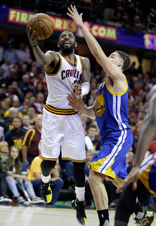 . Cleveland Cavaliers guard Kyrie Irving (2) drives on Golden State Warriors guard Klay Thompson, right, during the second half of Game 3 of basketball\'s NBA Finals in Cleveland, Wednesday, June 7, 2017. Golden State won 118-113. (AP Photo/Tony Dejak)