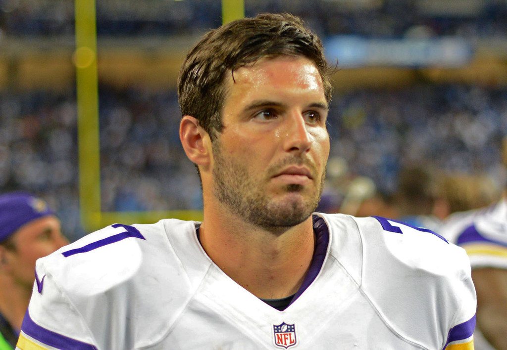 . Shell-shocked Vikings quarterback Christian Ponder walks off the field at the end of Minnesota\'s 34-24 loss to the Lions on Sunday. Ponder threw three interceptions and also fumbled the ball once.  (Pioneer Press: Chris Polydoroff)