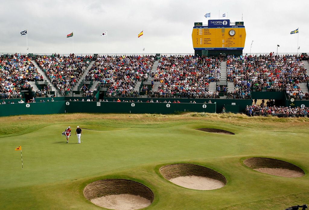 . Shane Lowry of Ireland walks to make a putt on the 18th green with his caddie Dermot Byrne during the final round of the British Open Golf championship at the Royal Liverpool golf club, Hoylake, England, Sunday July 20, 2014. (AP Photo)