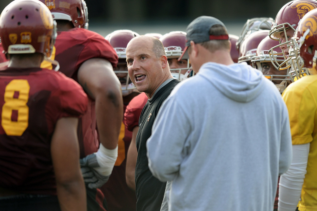 . USC offensive coordinator Clay Helton talks to his players during practice, Tuesday, March 25, 2014, at USC. (Photo by Michael Owen Baker/L.A. Daily News)