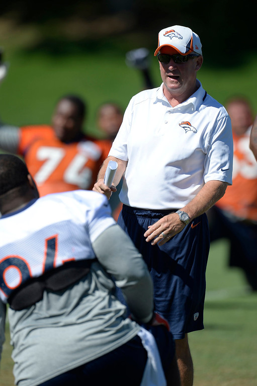 . Denver Broncos head coach John Fox talks with Denver Broncos defensive tackle Terrance Knighton (94) before practice  September 3, 2013 at Dove Valley. (Photo by John Leyba/The Denver Post)