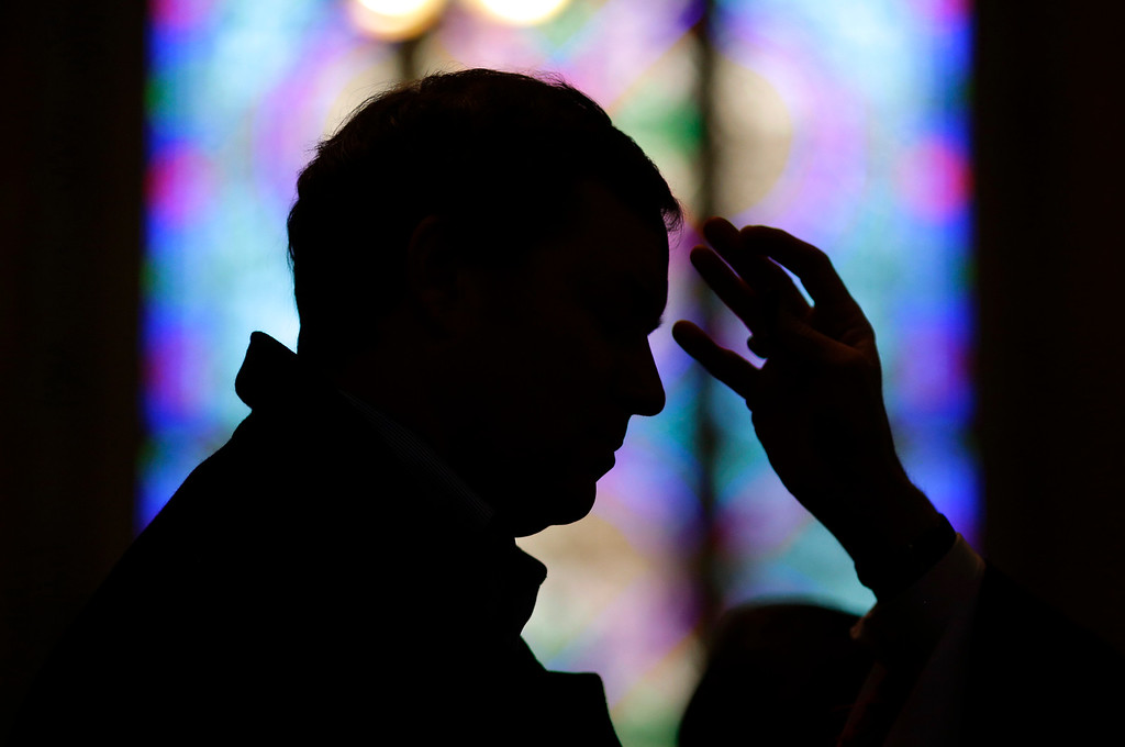 . A man receives ashes from Baltimore Archbishop William Lori during an Ash Wednesday Mass, Wednesday, Feb. 18, 2015, in Baltimore.  Ash Wednesday marks the start of the Lent, a season of prayer and fasting for Christians before Easter. (AP Photo/Patrick Semansky)