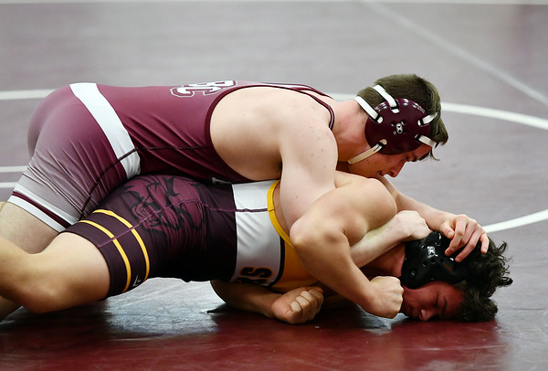 2/22/2020 Mike Orazzi | StaffrBristol Central's Matt Duquette and South Windsor's Wyatt Cote in a 152pound match during the Class L State Wrestling Tournament held at Bristol Central High School on Saturday.