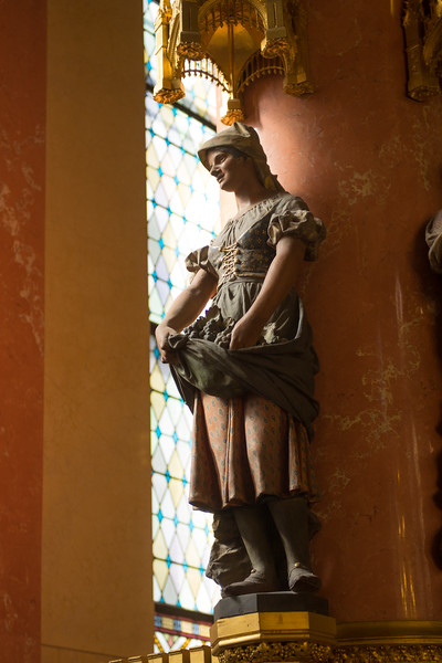 In one of the rooms, there are ornate statues of people of different occupations.