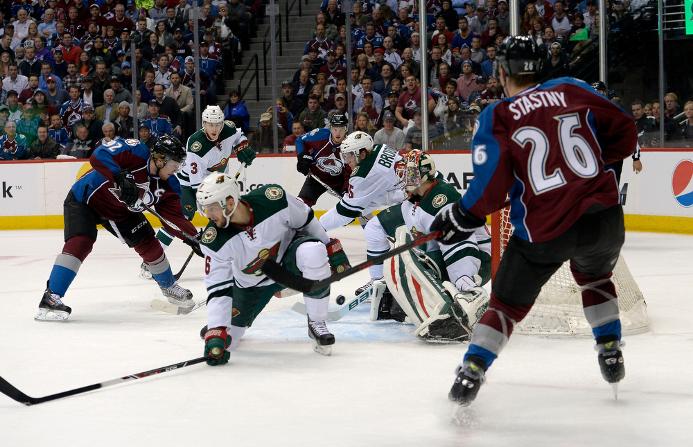 . Gabriel Landeskog (92) of the Colorado Avalanche fires a shot past goalie Ilya Bryzgalov (30) of the Minnesota Wild scoring the first goal of the game during the first quarter of action. The Colorado Avalanche hosted the Minnesota Wild for the first playoff game at the Pepsi Center on Thursday, April 17, 2014. (Photo by John Leyba/The Denver Post)