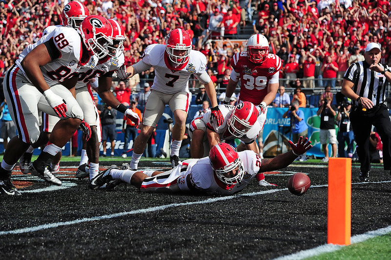 . Richard Samuel IV #22 of the Georgia Bulldogs is unable to recover a blocked punt in the end zone against the Nebraska Cornhuskers during the Capital One Bowl at the Citrus Bowl on January 1, 2013 in Orlando, Florida. Georgia would be awarded a safety for a 2-0 lead. (Photo by Scott Cunningham/Getty Images)