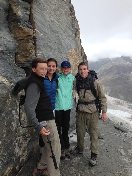 Ryan, Katerina, Marin, and Ben touching the base of the Matterhorn