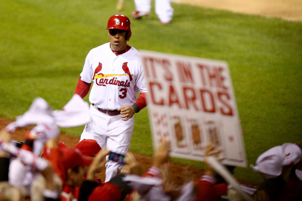 . ST LOUIS, MO - OCTOBER 18:  Carlos Beltran #3 of the St. Louis Cardinals celebrates after scoring a run in the third inning while taking on the Los Angeles Dodgers in Game Six of the National League Championship Series at Busch Stadium on October 18, 2013 in St Louis, Missouri.  (Photo by Ed Zurga/Getty Images)