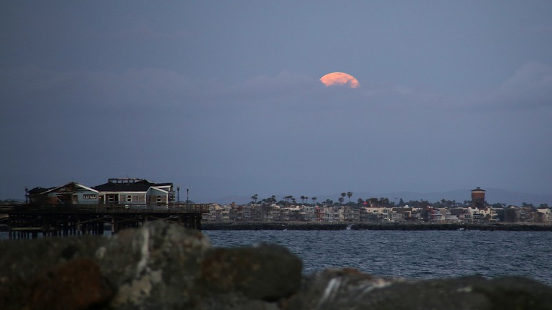 Full moonrise.   (Burned out diner on the Seal Beach Pier.)