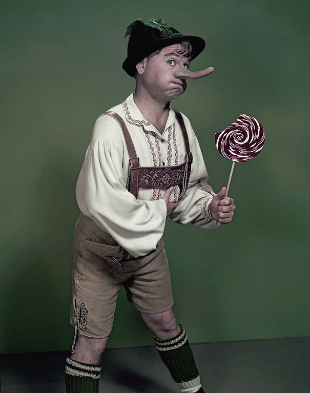 ". Actor Mickey Rooney portrays ""Pinnochio,\"" in this September 1957, file photo. Rooney, a Hollywood legend whose career spanned more than 80 years, has died. He was 93. Los Angeles Police Commander Andrew Smith said that Rooney was with his family when he died Sunday, April 6, 2014, at his North Hollywood home. (AP Photo/File)"