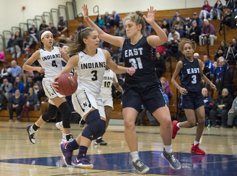 01/16/20  Wesley Bunnell | Staff  Newington girls basketball vs East Catholic in a game on Thursday Jan 16, 2019.  Newington's Ashanti Frazier would break the 1,000 points scored milestone during the first half. Karissa Zocco (3) drives to the basket.
