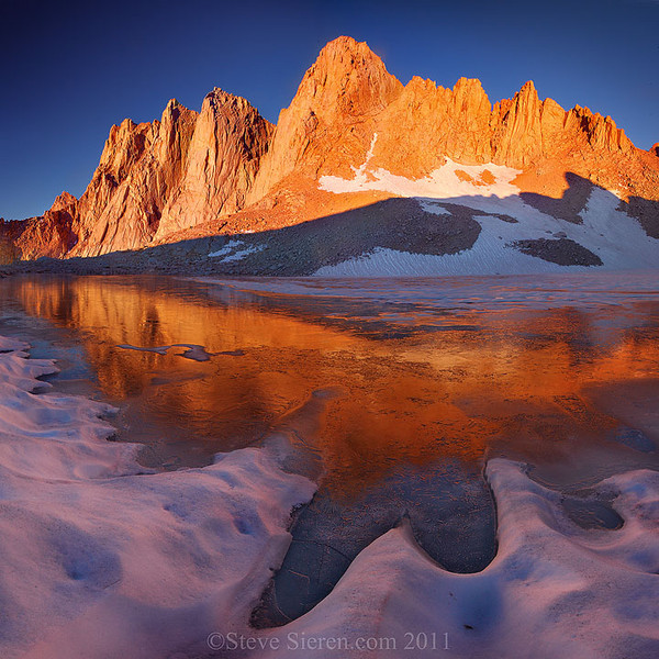 Icey reflecion of Mt Whitney covered in alpen glow in the high country of the Eastern Sierra.