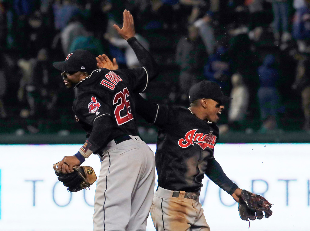 . Cleveland Indians\' Rajai Davis, left, and Francisco Lindor celebrate the team\'s 1-0 win over the Chicago Cubs during a baseball game Wednesday, May 23, 2018, in Chicago. (AP Photo/Jim Young)