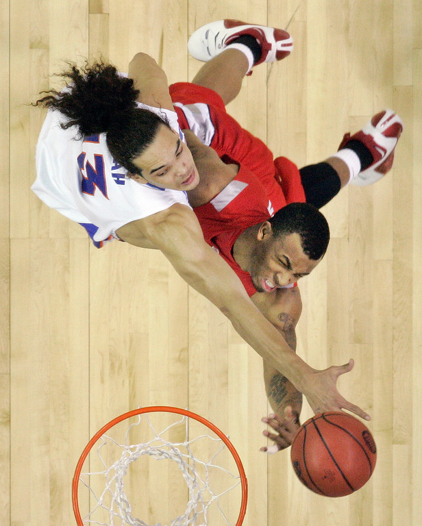 . Florida\'s Joakim Noah (13) goes up against Ohio State guard Daequan Cook (31) in the first half of theri  men\'s championship basketball game at the Final Four in the Georgia Dome in Atlanta Monday, April 2, 2007. (AP Photo/John Bazemore)