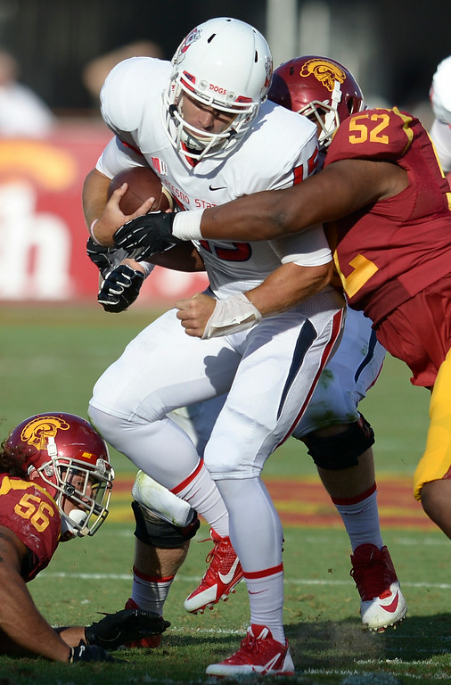 . Fresno QB #15 Brandon Connette is brought down by SC #52 Delvon Simmons in the 2nd quarter. USC played Fresno State at the Los Angeles Memorial Coliseum for the first game of the year. Los Angeles, CA. 8/30/2014(Photo by John McCoy Daily News