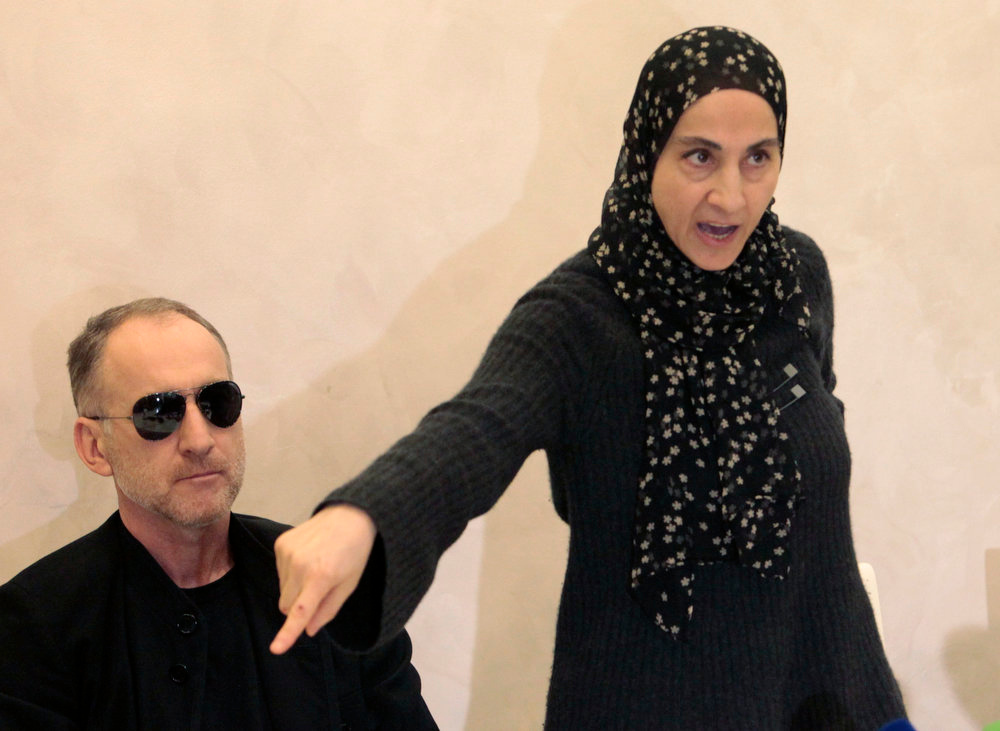 . The mother of the two Boston bombing suspects, Zubeidat Tsarnaeva, with the suspects\' father Anzor Tsarnaev, left, speaks at a news conference in Makhachkala, the southern Russian province of Dagestan, Thursday, April 25, 2013. The father of the two Boston bombing suspects said Thursday that he is leaving Russia for the United States in the next day or two, but their mother said she was still thinking it over. (AP Photo/Musa Sadulayev)
