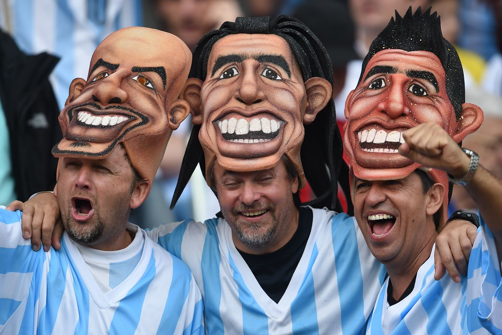 . Argentina\'s fans pose before the Group F football match between Nigeria and Argentina at the Beira-Rio Stadium in Porto Alegre during the 2014 FIFA World Cup on June 25, 2014.   AFP PHOTO / PEDRO UGARTE/AFP/Getty Images