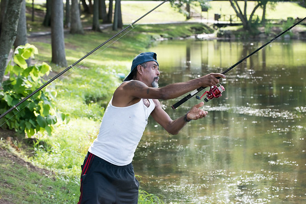 07/24/18 Wesley Bunnell | Staff Ramon Rodriguez casts the second of his lines into the water at Stanley Quarter Park on Tuesday afternoon.