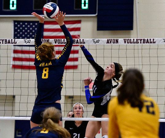 11/1/2018 Mike Orazzi | Staff Bristol Eastern's Ryley Plourde (11) and RHAM's Kaylin Hadley (8) during the CCC Volleyball Tournament at Avon High School Thursday night.