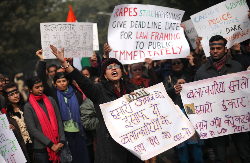 . An Indian woman shouts slogans during a protest to mourn the death of a gang rape victim in New Delhi, India, Thursday, Jan. 3, 2013. Indian police were preparing Thursday to file rape and murder charges against a group of men accused of sexually assaulting the 23-year-old university student for hours on a moving bus in New Delhi. The Dec. 16 attack on the woman, who later died of her injuries, has caused outrage across India, sparking protests and demands for tough new rape laws, better police protection for women and a sustained campaign to change society\'s views about women. (AP Photo/Altaf Qadri)