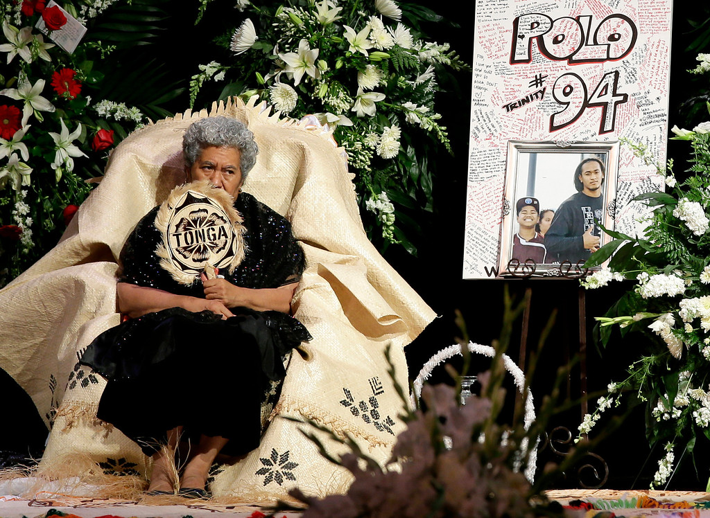". Sinai Falemaka, the family matriarch, fans herself as she sits on stage by the remains of Texas A&M redshirt freshman Polo Manukainiu and Andrew ""Lolo\"" Uhatafe during a memorial service at Trinity High School, Friday, Aug. 9, 2013, in Euless, Texas. Manukainiu,19, and Uhatafe, 13, were killed in a single car accident in Northern New Mexico, on July 29. Also killed was 18-year-old Utah recruit Gaius \""Keio\"" Vaenuku. (AP Photo/Tony Gutierrez)"