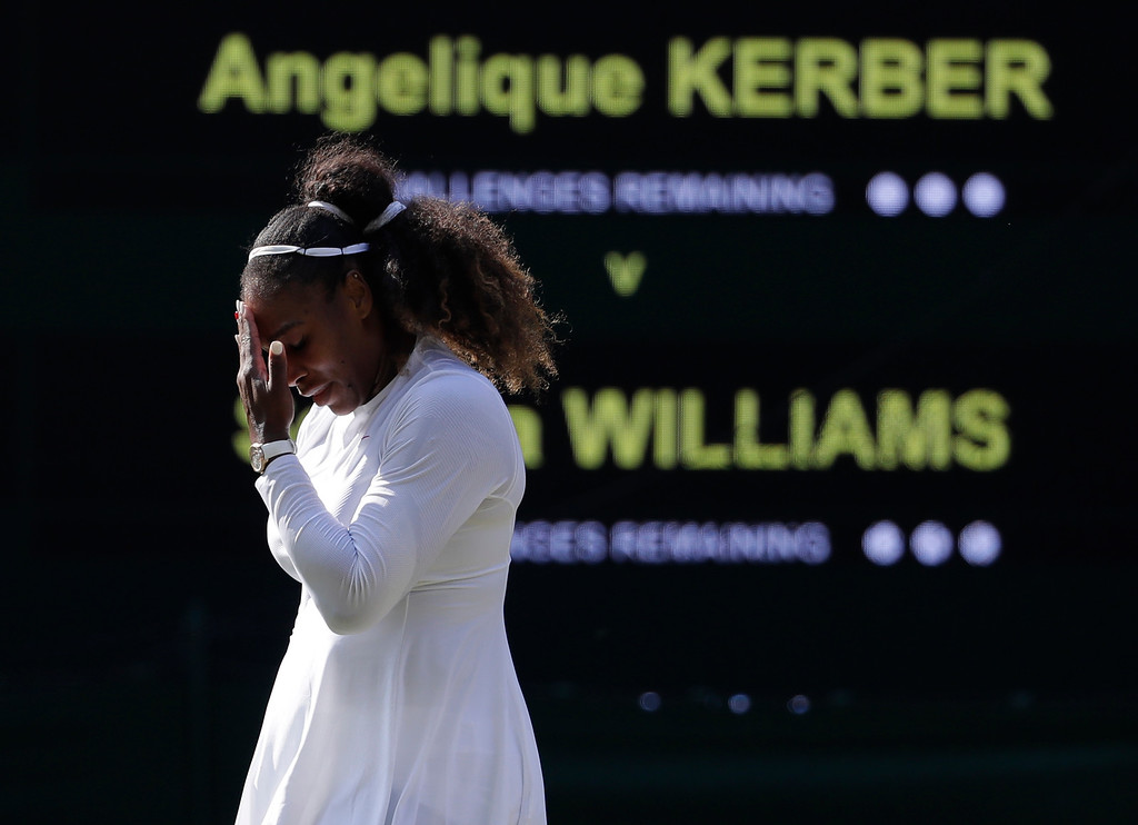. Serena Williams of the United States is dejected after losing a game during her women\'s singles final match against Germany\'s Angelique Kerber at the Wimbledon Tennis Championships, in London, Saturday July 14, 2018.(AP Photo/Ben Curtis)