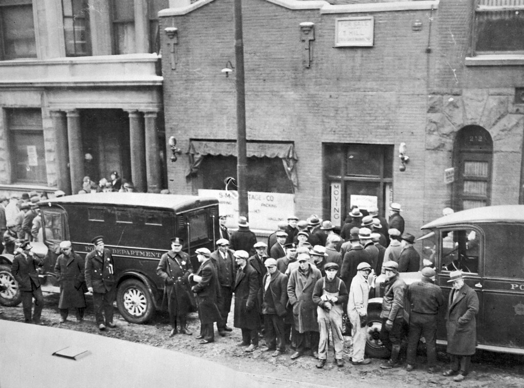 ". A photo provided by the Chicago History Museum shows police and people in front of the S.M.C. Cartage Co. garage on North Clark in Chicago on Feb. 14, 1929 following the St. Valentine\'s Day massacre. Five henchmen from mobster Al Capone\'s gang killed seven members of George ""Bugs\"" Moran\'s gang inside the garage. While Chicago officials today shun any association with the famous gangster, visitors still flock to the city searching for anything to do with Capone, who died 60 years ago on Jan. 25, 1947. (AP Photo/Chicago History Museum)"