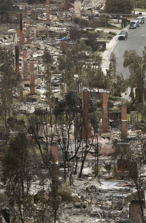 . Chimneys are all that stand in Scripps Ranch neighborhood in San Diego, Calif. Thursday, Oct. 30, 2003. The homes were among more than 1,500 lost in the 275,000 acre Cedar fire. (AP Photo/Charlie Riedel)